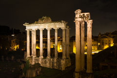 Temple of Saturn and Vespasian at night Stock Photos