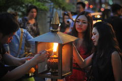 Temple Scene. Temple-goers light incense during a merit making ceremony at the Erawan Shrine on May 24, 2013 in Bangkok, Thailand. The shrine was built in 1956 Stock Image