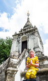 Temple sclupture. Thai temple sculpture have yellow color with blue sky Stock Photo