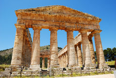 The Temple of Segesta. One of the most perfectly preserved monuments to survive from Antiquity, stands in majestic solitude on a hill surrounded by a deep Royalty Free Stock Photography