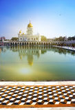 The temple of Sikh religion (1783 year) on the bank of a sacred reservoir, India, Delhi Royalty Free Stock Images