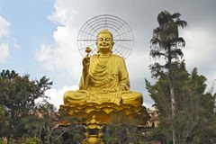 The Temple of Sitting Buddha in Dalat, Vietnam. The gold statue of sitting Buddha in Dalat, Vietnam Stock Images
