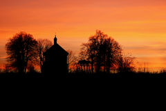 Temple. A small temple with a bell tower at sunset on the meadow Royalty Free Stock Images