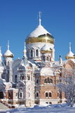 Temple in the snow against the blue sky. In the Perm region Royalty Free Stock Image