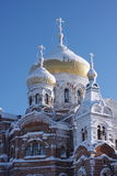 Temple in the snow against the blue sky. In the Perm region Royalty Free Stock Photos