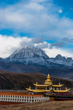 The temple, the snow mountain, and the moon. In tibetan area of Sichuan, China Stock Photo