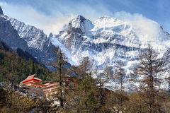 Temple on the snow mountains. Temple on the snow mountains in Yading, China Stock Images