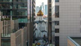 Temple of St. Nicholas timelapse in Tverskaya Zastava between office buildings in Moscow, Russia. Temple of St. Nicholas timelapse in Tverskaya Zastava between stock video footage