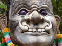 Temple statue face. Face of a temple statue in Thailand Stock Photos