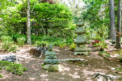 Temple Statues in Japanese Garden Royalty Free Stock Photography