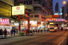 Temple Street Hong Kong, China. Hong Kong, China - January 4, 2012. Street scene at night in Kowloon, Hong Kong, China featuring the entrance to the landmark Royalty Free Stock Photos