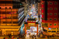 Temple Street night market Hong Kong. Temple Street illuminated artistic night market in Hong Kong Royalty Free Stock Image