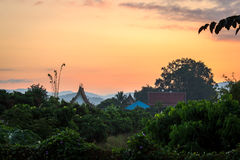 Temple Sunrise. Dawn breaks over the village Temple in Huai Kaew villlage, North of Chiang Mai Stock Photo