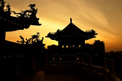 Temple sunset. Sunset at a chinese temple stock photos