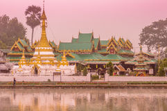 Temple at sunset. A view of a temple at sunset overlooking a lake in Mae Hong Son province in Thailand Royalty Free Stock Photos