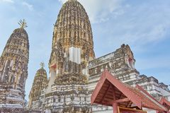 Temple in Thailand,old white pagoda with blue sky and old brick wall royalty free stock image