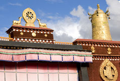 Temple in Tibet. Temple with religious icon on golden  rooftop   in Tibet Royalty Free Stock Photography