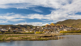 Temple in tibet in blue sky. Temple in Tibet at blue sky at noon, Songzanlin temple, panorama view Stock Photo
