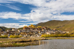 Temple in tibet in blue sky. Temple in Tibet at blue sky at noon, Songzanlin temple, panorama view Royalty Free Stock Photos