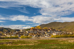 Temple in tibet in blue sky. Temple in Tibet at blue sky at noon, Songzanlin temple, panorama view Stock Photos