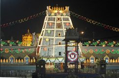 Temple to Lord Venkateswara at Tirupati, Andhra Pradesh, India. Illuminated Temple Tower, or Gopuram, at the entrance to the Hindu Temple of Lord Venkateswara royalty free stock photos