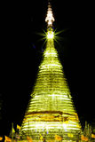 Temple to night. Gold color Sculpture Stock Image