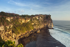 Temple on the top of the cliff. Bali.The temple Luhur Ulu Watu, towering on the top of a large cliff Royalty Free Stock Photography