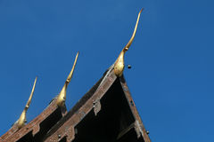 Temple. Top of Thai temple roof and blue sky Royalty Free Stock Photo