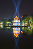 The temple turtle in the rays of searchlights at night. Hanoi. Vietnam Royalty Free Stock Photography