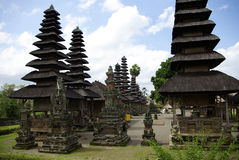 Temple with typical pointed roofs in Bali. This is a temple in Bali island with many typical pointed black roofs. The number of roofs depend of the type of god stock image