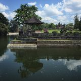 A temple in Ubud. A shot of a temple with its reflection in the lake of a temple in Ubud Royalty Free Stock Photos