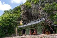 Temple under a cliff Royalty Free Stock Photography