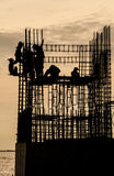 Temple Under Construction with Workers near Mangrove Forest Royalty Free Stock Images