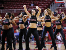 Temple University Diamond Gems dance team perform. PHILADELPHIA - DECEMBER 12: Members of the Temple University dance team (Diamond Gems) perform during a break royalty free stock photo