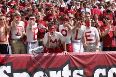 TTemple University fans spell out Temple in body paint Royalty Free Stock Photo