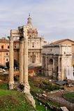 Temple of Vespasian and Arc of Septimius Severus. The remains of temple of Vespasian and the Arc of Septimius Severus on the Forum Romanum in Rome, Italy. The Stock Image