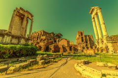 Temple of Vespasian columns located in the Roman Forum at mornin Royalty Free Stock Photo