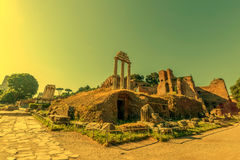 Temple of Vespasian columns located in the Roman Forum at mornin Stock Photography