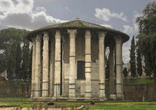 Temple of Vesta, Rome. The Temple of Vesta has a cirular footprint.   Vesta is the virgin goddess of the hearth, home, and family in Roman religion. She was Stock Photos