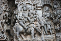 Hoysaleswara Temple wall carved with sculpture of lord shiva and parvati Royalty Free Stock Photos