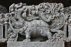 Hoysaleswara Temple wall carved with sculpture of Makara mythical animal carrying lord Varuna god of rain. This is Temple wall carved with sculpture of Makara Royalty Free Stock Photography