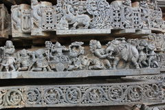 Temple wall carving depicting Battle scene from Mahabharata Indian Hindu Epic Royalty Free Stock Photography