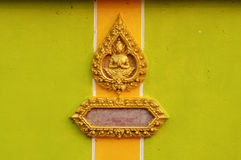 The temple wall. The Thai style pattern of golden god is on the wall of the temple at Nakhonpanom,Thailand Royalty Free Stock Photo