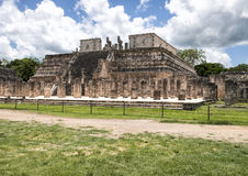 The Temple of the Warriors, Chichen Itza. The Temple of the Warriors complex consists of a large stepped pyramid fronted and flanked by rows of carved columns Stock Photography