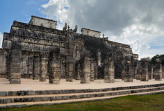 Temple of the Warriors in Mexican archaeological sight Chichen I. Beautiful ancient mayan temple with a quantity columns Stock Photos