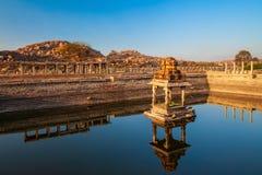 Hampi Vijayanagara Empire monuments, India. Temple and water tank at Hampi, the centre of the Hindu Vijayanagara Empire in Karnataka state in India stock photography