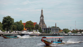Temple. Waterfront and a boat in Thailand Stock Photography