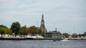 Temple. Waterfront and a boat in Thailand Royalty Free Stock Photos