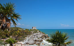 Temple of the Wind at Tulum Mayan ruins overlooking the Caribbean coastline south of Playa Del Carmen and Cancun on Mexico's. Yucatan peninsula MEX Royalty Free Stock Images