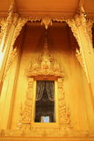 Temple window. Gold paint temple window with thai architecture and painting royalty free stock image